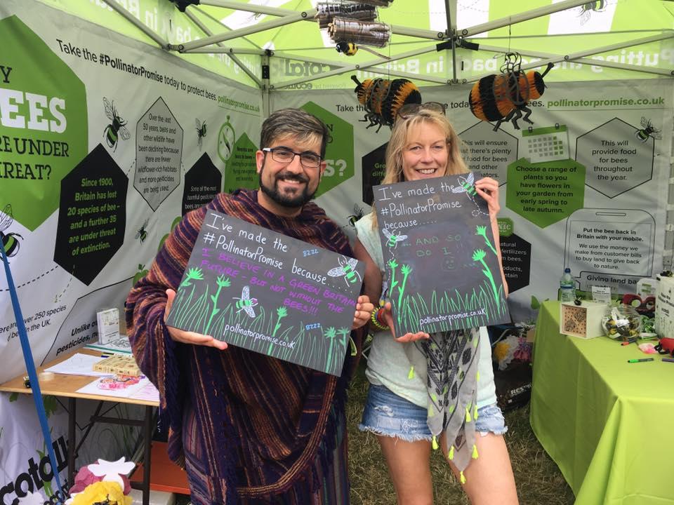 Helen standing next to Joe holding a chalk board up